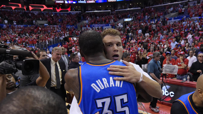 Oklahoma City Thunder forward Kevin Durant, hugs Los Angeles Clippers forward Blake Griffin after the Thunder won of Game 6 of the Western Conference semifinal NBA basketball playoff series, Thursday, May 15, 2014, in Los Angeles. The Thunder won104-98, taking the series 4-2. (AP Photo/Mark J. Terrill)