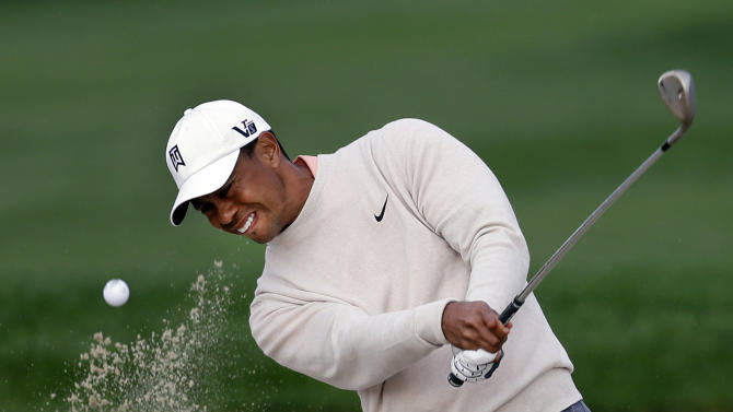 Tiger woods hits out of a bunker on the 13th hole during the first round of the Honda Classic golf tournament, Thursday, Feb. 28, 2013, in Palm Beach Gardens, Fla. (AP Photo/Wilfredo Lee)
