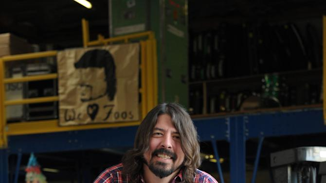 Musician Dave Grohl poses for a portrait at 606 Sound on Wednesday, Jan. 9, 2013, in Los Angeles. (Photo by John Shearer/Invision/AP)