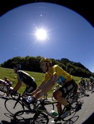 Overall leader's yellow jersey, British Bradley Wiggins, rides in the pack in the sixteenth stage of the 2012 Tour de France cycling race starting in Pau and finishing in Bagneres de Luchon, southern France