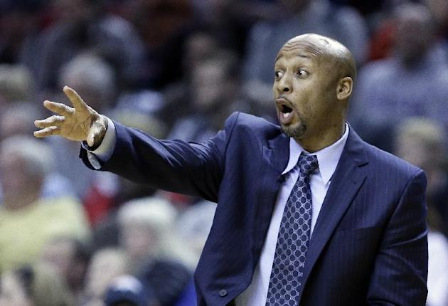 Denver Nuggets coach Brian Shaw calls out from the bench during the second half of an NBA basketball game against the Portland Trail Blazers  in Portland, Ore., Thursday, Jan. 23, 2014. Portland won 1