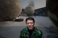This photo taken on December 11, 2012 shows farmer Liu Qiyuan with the survival pods that he created and dubbed &quot;Noah&#39;s Arc&quot;, in the village of Qiantun, south of Beijing. As people across the globe tremble in anticipation of next week&#39;s supposed Mayan-predicted apocalypse, Liu says he may have just what humanity needs
