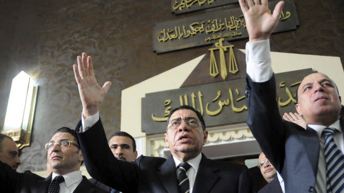 Egyptian Prosecutor General Abdel-Meguid Mahmoud addresses hundreds of supporters, judges, lawyers and media, not shown, in a downtown courthouse defying a presidential decision to remove him from his post, saying this infringes on the judiciary's independence, in Cairo, Egypt, Saturday, October 13, 2012. President Mohammed Morsi ordered Prosecutor General Abdel-Meguid Mahmoud to step down to appease public anger over the acquittals of ex-regime officials accused of orchestrating violence against protesters last year. (AP Photo/Mohmmed Asad)