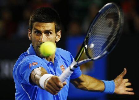 Djokovic of Serbia hits a return to Muller of Luxembourg during their men's singles match at the Australian Open 2015 tennis tournament in Melbourne