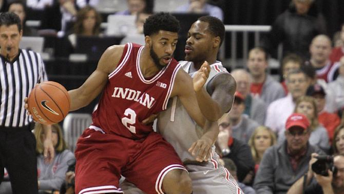 Indiana's Christian Watford, left, posts up against Ohio State's Deshaun Thomas during the first half of an NCAA college basketball game on Sunday, Feb. 10, 2013, in Columbus, Ohio. (AP Photo/Jay LaPrete)