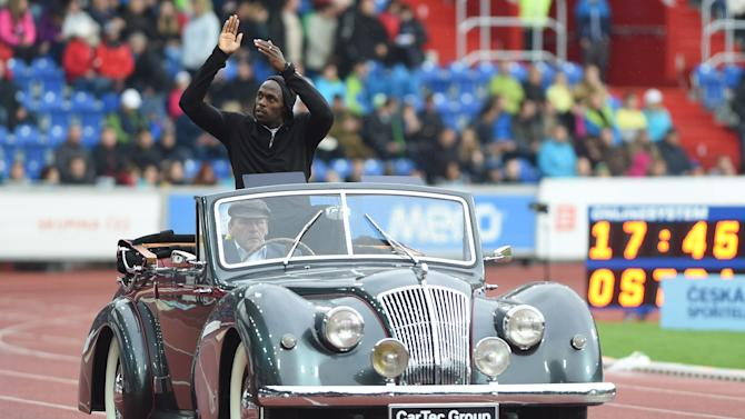 Jamaican sprinter Usain Bolt in a historical car greets spectators during the opening ceremony of the Golden Spike athletic meeting in Ostrava, Czech Republic, Tuesday, May 26, 2015. (Jaroslav Ozana/CTK via AP) SLOVAKIA OUT