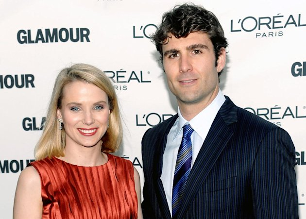 FILE-In this Monday, Nov. 9, 2009, file photo, Marissa Mayer and Zachery Bogue attend the Glamour Magazine 2009 Women of the Year Awards at Carnegie Hall in New York. Yahoo CEO Marissa Mayer gave birth to a boy late Sunday Sept. 30, 2012, casting a spotlight on her ability to steer the struggling Internet company in a new direction while adjusting to the challenges of being a first-time mother. The birth came a week ahead of the Oct. 7 due date that Mayer shared with the public in July. She announced her pregnancy on her social networking accounts just a few hours after Yahoo hired her as its third full-time CEO in less than a year. (AP Photo/Evan Agostini)