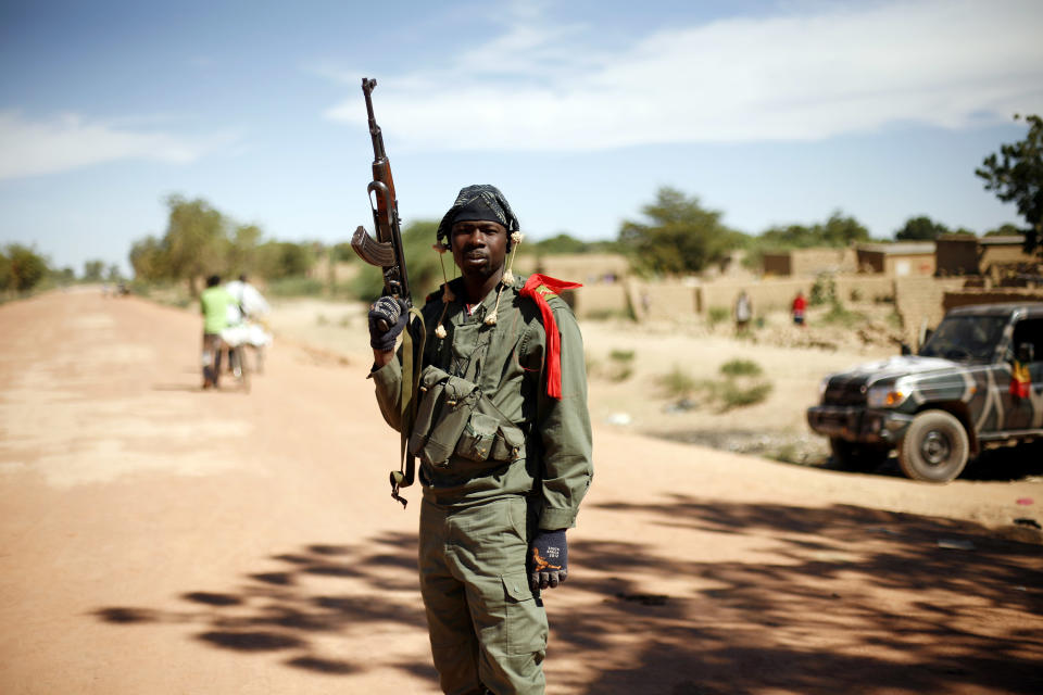 A Malian soldier mans a checkpoint  on the outskirt of Diabaly, Mali,  some  460kms (320 miles) north of the capital Bamako Monday Jan. 21, 2013.  French and Malian troops were in the city whose capture  by radical Islamists prompted the French military intervention. (AP Photo/Jerome Delay)