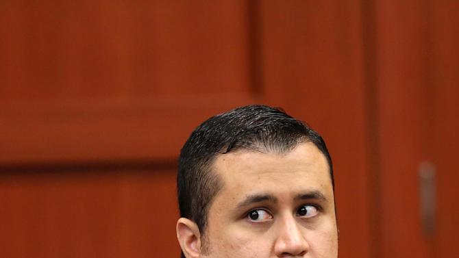 George Zimmerman glances back at the gallery during a recess in his trial in Seminole circuit court in Sanford, Fla., Monday, June 17, 2013. Zimmerman has been charged with second-degree murder for the 2012 shooting death of Trayvon Martin.(AP Photo/Orlando Sentinel, Joe Burbank, Pool)