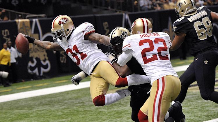 San Francisco 49ers strong safety Donte Whitner (31) scores on a touchdown run in the second half of an NFL football game against the New Orleans Saints in New Orleans, Sunday, Nov. 25, 2012. (AP Photo/Bill Feig)