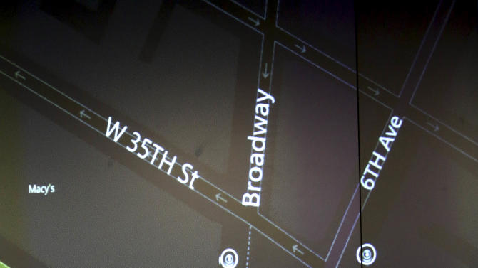 """This Tuesday, Feb. 19, 2013 photo shows a detail of a video wall showing New York city police officers an interactive map of an area in the city, security footage from nearby cameras, if there are high radiation levels and whether any other threats have been made in New York. The Domain Awareness System, known as """"the dashboard,"""" instantaneously mines data from the NYPD's vast collection of arrest records, 911 calls, more than 3,000 security cameras city-wide, license plate readers and portable radiation detectors and aggregates it into a user-friendly, readable form. (AP Photo/Mary Altaffer)"""