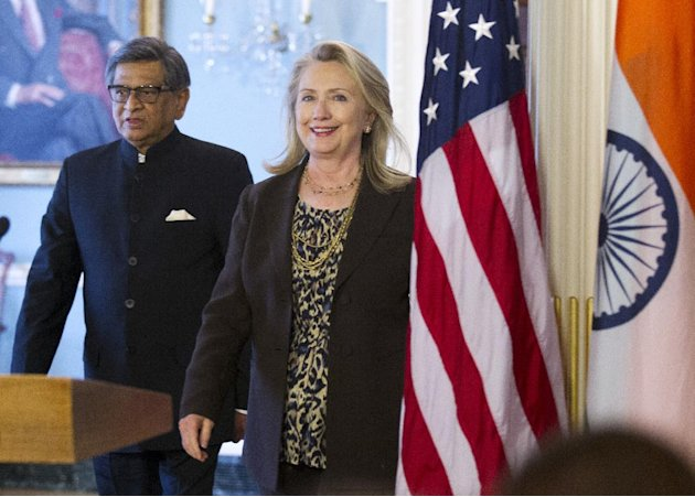 Secretary of State Hillary Rodham Clinton and Indian Foreign Minister S.M. Krishna walk to a joint news conference, Wednesday, June 13, 2012,  at the State Department in Washington.  (AP Photo/Manuel