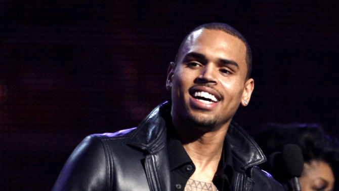 "FILE - In this Feb. 12, 2012 file photo, Chris Brown accepts the award for best R&B album for ""F.A.M.E."" during the 54th annual Grammy Awards in Los Angeles. A Los Angeles County Sheriff's Department spokesman said Monday Feb. 4, 2013, that the agency expects to close its investigation into a fight between Brown and Ocean last month due to online comments Ocean recently posted stating he was not interested in pressing charges against Brown. (AP Photo/Matt Sayles, File)"