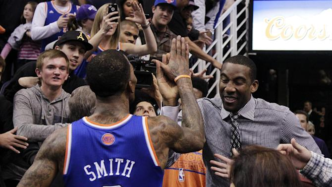 New York Knicks' Amare Stoudemire celebrates with J.R. Smith after Smith hit the game-winning shot against the Phoenix Suns after an NBA basketball game, Wednesday, Dec. 26, 2012, in Phoenix. The Knicks won 99-97. (AP Photo/Matt York)