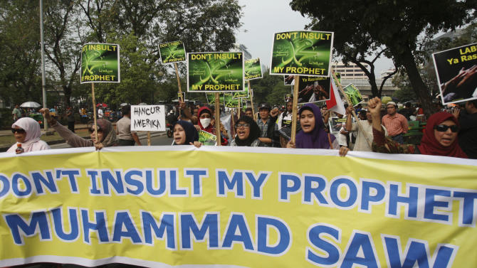 "Indonesian Muslims carry a banner reading: ""Don't insult my Prophet Muhammad"" during a protest against an anti-Islam film that has sparked anger among followers, outside the U.S. Embassy in Jakarta, Indonesia, Friday,  Sept. 21, 2012. The U.S. has closed its diplomatic missions across Indonesia due to continuing demonstrations over the American-produced film ""Innocence of Muslims,"" which denigrates the Prophet Muhammad. (AP Photo/Achmad Ibrahim)"