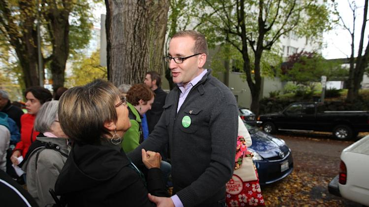 IMAGE DISTRIBUTED FOR HUMAN RIGHTS CAMPAIGN - Human Rights Campaign President, Chad Griffin, speaks with supporters of Catholics for Marriage equality including Washington State Representative Ed Murray (D-43rd), outside St. James Cathedral in Seattle on Sunday, October 28, 2012. Human Rights Campaign, the largest LGBT advocacy and political lobbying organization in the United States. (Kevin P. Casey/AP Images for Human Rights Campaign)