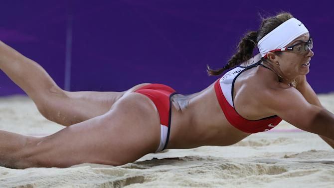 United States' Misty May-Treanor dives for a ball during the women's gold medal beach volleyball match against the other US team `at the 2012 Summer Olympics, Wednesday, Aug. 8, 2012, in London. (AP Photo/Petr David Josek)