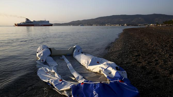 A deflated dingy boat, which was earlier used by immigrants to cross from Turkey to Greece, is seen on a beach on the Greek island of Kos