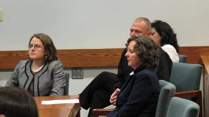 Susan Hendricks, front right, listens to a psychologist testify about her mental condition before she is sentenced to life in prison on Friday, April 26, 2013, in Pickens, S.C. Hendricks pleaded guilty but mentally ill to killing four family members in October 2011 in Liberty, S.C. Hendricks, 49, accepted a life sentence in a plea bargain with prosecutors. (AP Photo/Jeffrey Collins)
