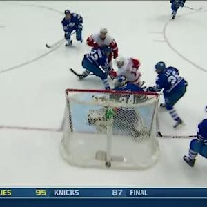 Pavel Datsyuk roofs the backhand on Reimer