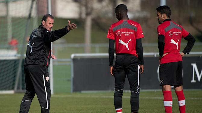 New head coach of German soccer club VfB Stuttgart, Huub Stevens, left.  advises Antonio Ruediger, second left,   and Karim Haggui right,  during a training session in Stuttgart, Germany Monday March 10, 2014