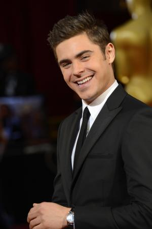 Zac Efron arrives at the Oscars on Sunday, March 2, 2014, at the Dolby Theatre in Los Angeles. (Photo by Dan Steinberg/Invision/AP)