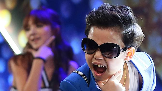 "In this Wednesday, Dec. 12, 2012 photo. South Korean Hwang Min-woo, the 7-year-old nicknamed ""Little PSY,"" performs during a concert in Seoul, South Korea. Hwang on Wednesday, March. 6, 2013, said that he wanted to gain global fame like his ""big brother,"" PSY during his press conference. (AP Photo/Yonhap, Han Jong Chan)  KOREA OUT"