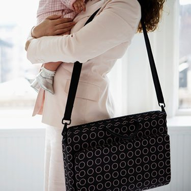 Businesswoman-holding-baby_web