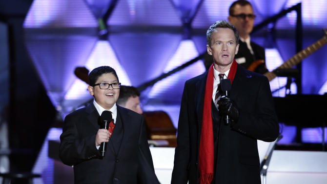 Rico Rodriguez, left, and host Neil Patrick Harris participate in the 90th annual National Christmas Tree Lighting ceremony on the Ellipse south of the White House, Thursday, Dec. 6, 2012 in Washington. (AP Photo/Alex Brandon)