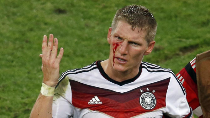 Germany's Bastian Schweinsteiger reacts as blood flows down his face after he was fouled during their 2014 World Cup final against Argentina at the Maracana stadium in Rio de Janeiro