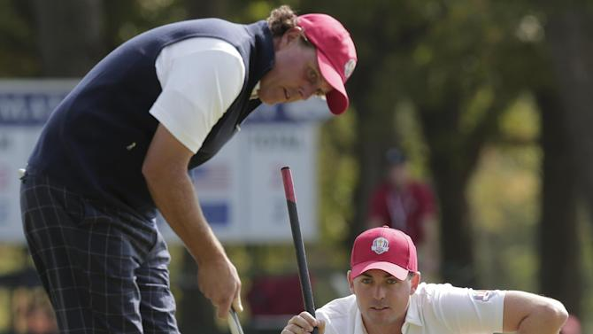 USA's Phil Mickelson and Keegan Bradley line up a putt on the fourth hole during a four-ball match at the Ryder Cup PGA golf tournament Friday, Sept. 28, 2012, at the Medinah Country Club in Medinah, Ill. (AP Photo/Charlie Riedel)