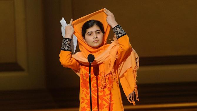 Education activist Malala Yousafzai accepts The Women of the Year Fund Honoree Award on stage at the 2013 Glamour Women of the Year Awards on on Monday, Nov. 11, 2013 in New York. (Photo by Brad Barket/Invision /AP Images)