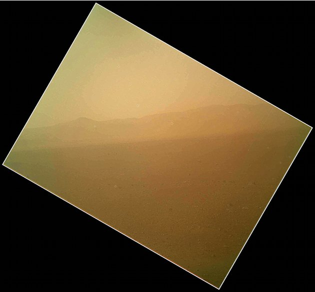 This image released on Tuesday Aug. 7,2012 by NASA shows the first color view of the north wall and rim of Gale Crater where NASA's rover Curiosity landed Sunday night. The picture was taken by the ro