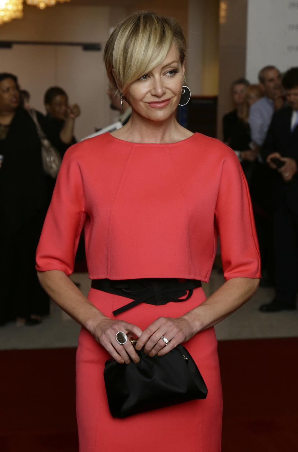 Actress Portia de Rossi, wife of Ellen DeGeneres, poses for photographers on the red carpet before entertainer Ellen DeGeneres receives the 15th annual Mark Twain Prize for American Humor at the Kennedy Center, Monday, Oct. 22, 2012, in Washington. (AP Photo/Alex Brandon)