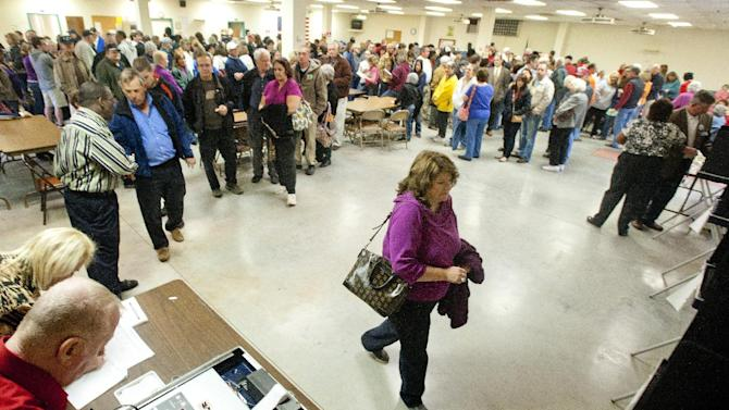 Voters wait in line for over an hour to vote at the Moose Lodge polling site in Campbell County on Tuesday, Nov. 6, 2012, in Lynchburg, Va. (AP Photo/News & Daily Advance, Jill Nance)