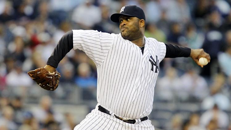 New York Yankees starting pitcher CC Sabathia winds up in the second inning against the Atlanta Braves during their baseball game at Yankee Stadium in New York, Monday, June 18, 2012. (AP Photo/Kathy Willens)