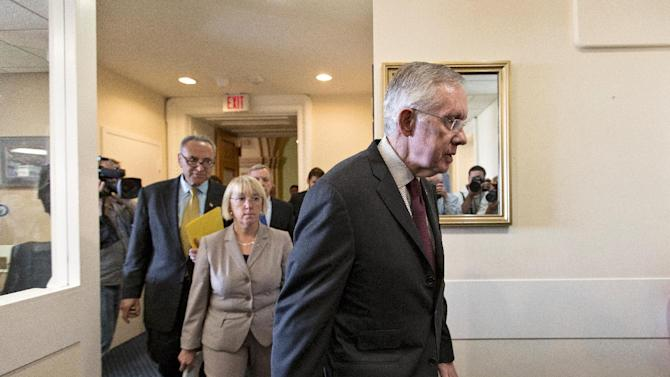 Senate Majority Leader Harry Reid, D-Nev., center, followed by Sen. Patty Murray, D-Wash., chair of the Senate Budget Committee, and Sen. Chuck Schumer, D-N.Y., arrive to speak to reporters after the Democratic-led Senate rejected conditions that House Republicans attached to a temporary spending bill, at the Capitol in Washington, Monday, Sept. 30, 2013. On the brink of a government shutdown, the Senate voted 54-46 on Monday to strip a one-year delay in President Barack Obama's health care law from the bill that would keep the government operating. (AP Photo/J. Scott Applewhite)