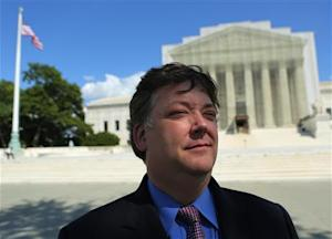 Shaun McCutcheon is pictured in front of the United States Supreme Court in Washington