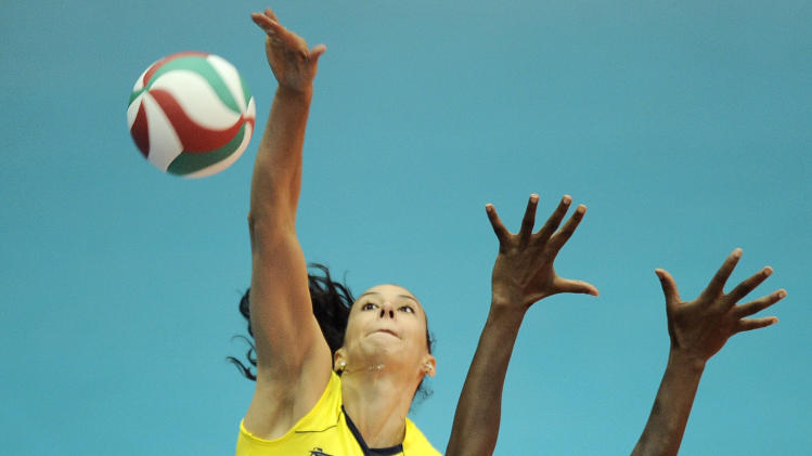 Sheila De Castro from Brazil spikes the ball during a women's volleyball final match against Cuba at the Pan American Games in Guadalajara, Mexico, Thursday, Oct. 20, 2011. (AP Photo/Daniel Ochoa de Olza)