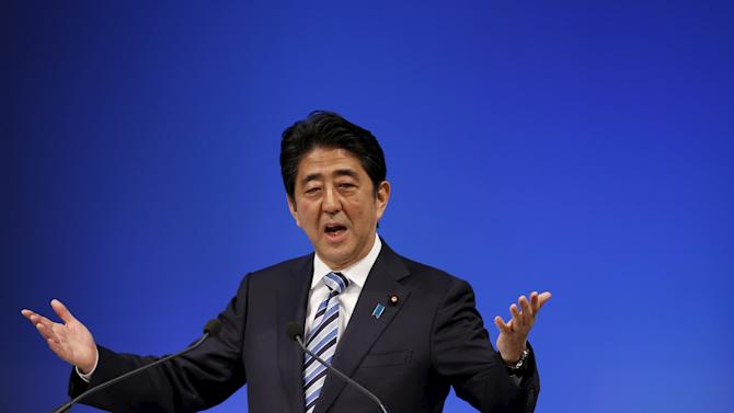 Japan's PM Abe, who is also the ruling LDP leader,delivers a speech during a ceremony for the LPD's 60th anniversary in Tokyo