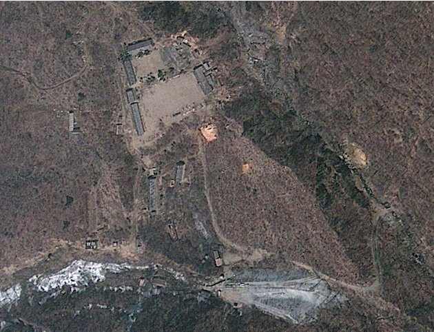In this April 18, 2012 file satellite image provided by GeoEye appears to show a train of mining carts, at the lower center of the frame, and other preparations underway at North Korea's Punggye-r