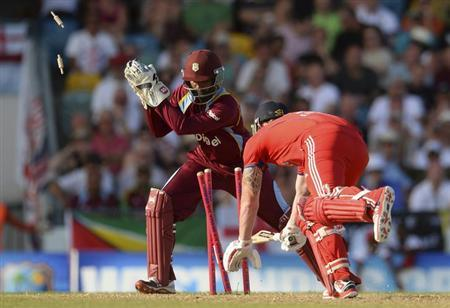 England's Ben Stokes (R) is stumped by West Indies' Denesh Ramdin during the first T20 international cricket match at Kensington Oval in Bridgetown March 9, 2014. REUTERS/Philip Brown