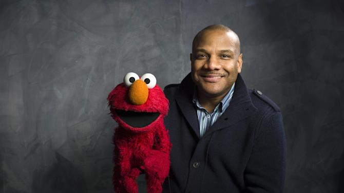 """FILE - This Jan. 24, 2011 photo shows """"Sesame Street"""" muppet Elmo and puppeteer Kevin Flash poses for a portrait in the Fender Music Lodge during the 2011 Sundance Film Festival to promote the film """"Being Elmo"""" in Park City, Utah. Clash has taken a leave of absence from the popular kids' show following allegations that he had a relationship with a 16-year-old boy. Sesame Workshop says Kevin Clash denies the charges, which were first made in June by the alleged partner, who by then was 23. In a statement issued Monday, Nov. 12, 2012, Sesame Workshop says its investigation found the allegation of underage conduct to be unsubstantiated.   (AP Photo/Victoria Will, file)"""