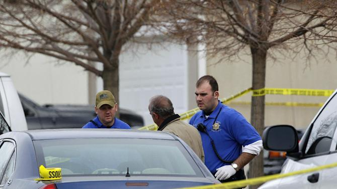 "Police investigators work at the scene of an apparent murder-suicide, which officials say left four dead inside a home, according to officials, in Longmont, Colo., Tuesday Dec. 18, 2012.  Weld County sheriff's spokesman Tim Schwartz says dispatchers heard the woman who called 911 scream ""No, no, no,"" and then they heard a gunshot. Schwartz says a man grabbed the phone and said he was going to kill himself, and dispatchers heard another shot.  (AP Photo/Brennan Linsley)"