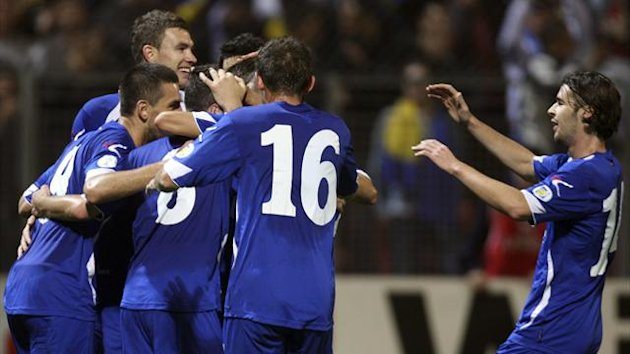 Bosnia players celebrate a Miralem Pijanic goal during their 2014 World Cup qualifying soccer match against Lithuania in Zenica