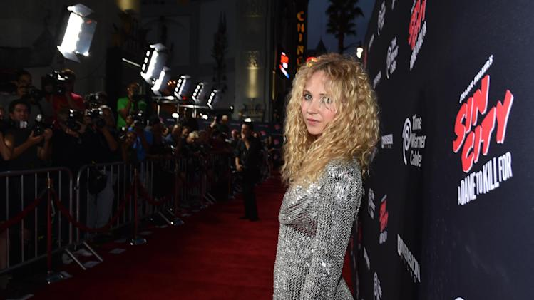 "Juno Temple arrives at the ""Sin City: A Dame to Kill For"" premiere presented by Dimension Films in partnership with Time Warner Cable, Dodge and DeLeon Tequila at TCL Chinese Theatre on Tuesday, August 19, 2014, in Los Angeles. (Photo by John Shearer/Invision for The Weinstein Company/AP Images)"