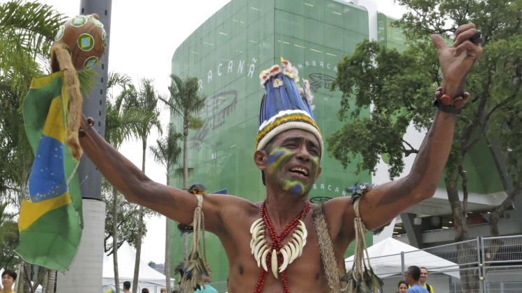 An indigenous man gestures in front of Maracana stadium prior to the soccer Confederations Cup final between Brazil and Spain in Rio de Janeiro, Brazil, Sunday, June 30, 2013. (AP Photo/Tales Azzoni)