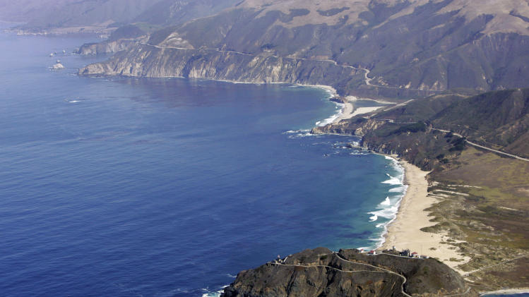 FILE-   This Sept. 24, 2006 file photo shows the Point Sur State Marine Reserve in an aerial view in Big Sur, Calif. The road to Big Sur is a narrow, winding one, with the Pacific Ocean on one side, spread out like blue glass, and a mountainside of redwoods on the other.   (AP Photo/Marcio Jose Sanchez)