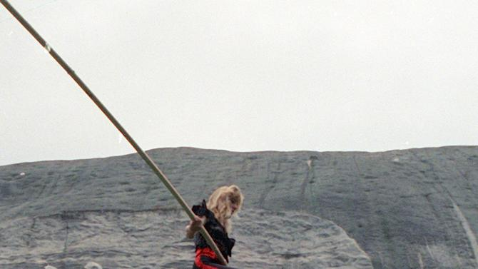 """FILE- In this Sept. 21, 1991 file photo, aerialist Angel Wallenda walks the high-wire performs at Stone Mountain, Ga. Wallenda, who lost a leg to cancer but trained herself to walk the wire with the help of a prosthetic leg, eventually died of the disease on May 3, 1996, at age 28. On Friday, June 15, 2012, Nik Wallenda, a seventh generation """"Flying Wallenda,"""" will attempt a high-wire crossing of the Niagra Falls gorge between the United States and Canada. The event will be covered on live television.  (AP Photo/Charles Kelly, File)"""