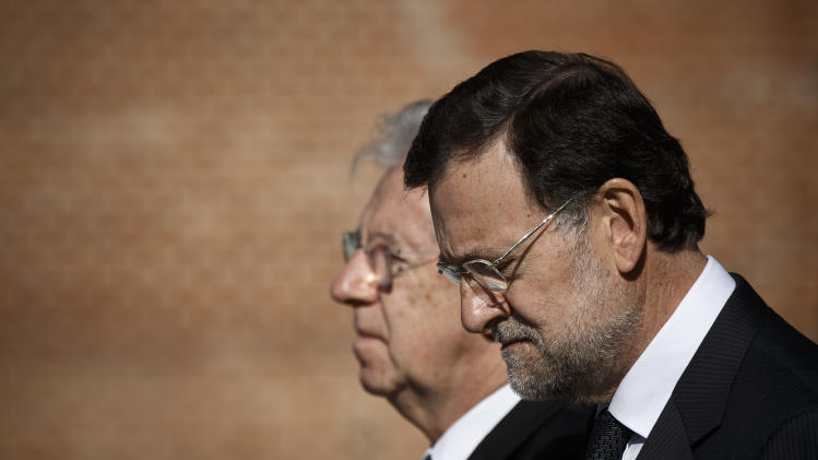 Spain's Rajoy rules out imminent request for help